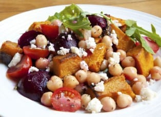 Vegetarian salad with chickpeas, baby beets, roasted pumpkin, cherry tomatoes, red onion, rocket and feta cheese.  Delicious healthy eating.